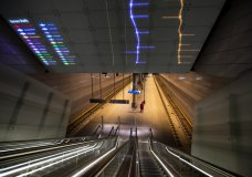 A lone traveller waits for the metro on a near-deserted platform in Amsterdam, Netherlands, Friday, April 24, 2020. The Dutch largely heed government guidelines to stay at home to curb the spread of the coronavirus. (AP Photo/Peter Dejong)