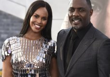 "FILE - In a Saturday, July 13, 2019 file photo, cast member Idris Elba, center, arrives with his wife Sabrina Dhowre Elba, left, and Isan Elba, right, at the Los Angeles premiere of ""Fast & Furious Presents: Hobbs & Shaw"", at the Dolby Theatre. Idris Elba says he and his wife had their lives ""turned around"" after contracting the coronavirus. (Photo by Jordan Strauss/Invision/AP, File)"