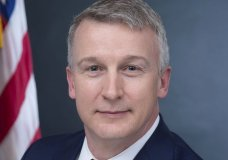 """In this image provided by Public Health Emergency, a department of Health and Human Services, Rick Bright is shown in his official photo from April 27, 2017, in Washington. America faces the """"darkest winter in modern history"""" unless leaders act decisively to prevent a rebound of the coronavirus, says Bright, a government whistleblower who alleges he was ousted from his job for warning the Trump administration to prepare for the pandemic. (Health and Human Services via AP)"""