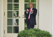 President Donald Trump gestures to people in the audience after an event on protecting seniors with diabetes in the Rose Garden White House, Tuesday, May 26, 2020, in Washington. (AP Photo/Evan Vucci)