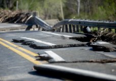 Damages on one of two North M-30 bridges on Wednesday, May 20, 2020 in Edenville Township north of Midland. After two days of heavy rain, the Edenville Dam failed and flood waters rushed south, ravaging the landscape in its path. (Jake May/The Flint Journal, MLive.com via AP)