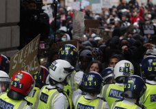 Protesters confront police during the Black Lives Matter protest rally in London, Sunday, June 7, 2020, in response to the recent killing of George Floyd by police officers in Minneapolis, USA, that has led to protests in many countries and across the US. (AP Photo/Frank Augstein)
