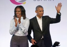 "FILE - In this Oct. 31, 2017, file photo, former President Barack Obama, right, and former first lady Michelle Obama appear at the Obama Foundation Summit in Chicago. Obama said in a commencement speech Sunday, June 7, 2020, that the nationwide protests following the recent deaths of unarmed black women and men including George Floyd were fueled from ""decades worth of anguish, frustration, over unequal treatment and a failure to perform police practices."" (AP Photo/Charles Rex Arbogast, File)"