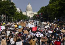 Demonstrators walk along Pennsylvania Avenue as they protest the death of George Floyd, Wednesday, June 3, 2020, in Washington. Floyd died after being restrained by Minneapolis police officers. (AP Photo/Evan Vucci)