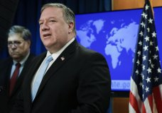 Secretary of State Mike Pompeo speaks as Attorney General William Barr listens, during a joint briefing, Thursday, June 11, 2020 at the State Department in Washington, on an executive order signed by President Donald Trump aimed at the International Criminal Court. Trump has lobbed a broadside attack against the International Criminal Court. He's authorizing economic sanctions and travel restrictions against court workers directly involved in investigating American troops and intelligence officials for possible war crimes in Afghanistan without U.S. consent. The executive order Trump signed on Thursday marks his administration's latest attack against international organizations, treaties and agreements that do not hew to its policies. (Yuri Gripas/Pool via AP)