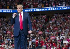 President Donald Trump arrives on stage to speak at a campaign rally at the BOK Center, Saturday, June 20, 2020, in Tulsa, Okla. Trump is asking Americans to let him keep his job. His critics are asking how much of that job he's actually doing. Those questions have gotten louder in recent days following revelations that Trump didn't read at least two written intelligence briefings detailing concerns that Russia was paying bounties to the Taliban for the deaths of Americans in Afghanistan. (AP Photo/Evan Vucci)