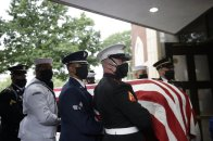 A military honor guard moves the casket of Rep. John Lewis into Ebenezer Baptist Church for his funeral, Thursday, July 30, 2020, in Atlanta. Lewis, who carried the struggle against racial discrimination from Southern battlegrounds of the 1960s to the halls of Congress, died Friday, July 17, 2020. (AP Photo/Brynn Anderson)