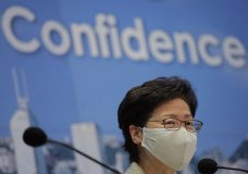 Hong Kong Chief Executive Carrie Lam, wearing mask to protect against the coronavirus, speaks during a news conference in Hong Kong, Friday, Aug. 21, 2020. (AP Photo/Kin Cheung)