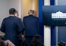 President Donald Trump is asked to leave the James Brady Press Briefing Room by a member of the U.S. Secret Service during a news conference at the White House, Monday, Aug. 10, 2020. (AP Photo/Andrew Harnik)