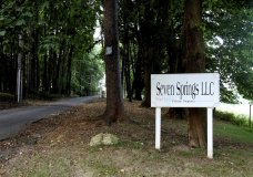 FILE - The entrance to Seven Springs LLC, in Bedford, N.Y., a property owned by the Trump family, is quiet, Sept. 23, 2009. New York's Attorney General Letitia James asked a court to enforce subpoenas into an investigation into whether President Donald Trump and his businesses inflated assets on financial statements. The filing includes Seven Springs. (AP Photo/Craig Ruttle, File)