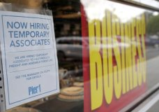A sign advertises hiring of temporary associates at a Pier 1 retail store, which is going out of business, during the coronavirus pandemic, Thursday, Aug. 6, 2020, in Coral Gables, Fla. The home goods retailer is going out of business and is permanently closing all of its stores. (AP Photo/Lynne Sladky)