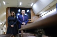President Donald Trump and first lady Melania Trump pause for a moment of silence on Air Force One as he arrives at the airport in Johnstown, Pennsylvania, on his way to speak at the Flight 93 National Memorial (AP Photo/Alex Brandon)