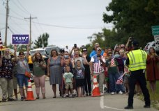 People line up to watch as the motorcade with President Donald Trump passes by Tuesday, Sept. 1, 2020, in Kenosha, Wis. (AP Photo/Evan Vucci)
