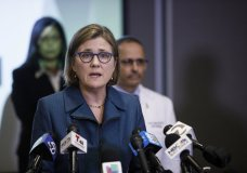 "FILE - In this March 16, 2020, file photo, Dr. Sara Cody, Santa Clara County Public Health Officer, speaks during a news conference headed by public health directors spanning six Bay Area counties in San Jose, Calif. Authorities say a Gilroy community college instructor with ties to the far-right, anti-government ""boogaloo"" movement is in custody following his arrest over two dozen threatening letters sent to Cody over months in the coronavirus pandemic. (Dai Sugano/Bay Area News Group via AP)"