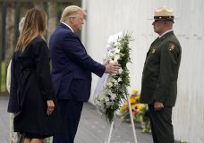 President Donald Trump lays a wreath at a 19th anniversary observance of the Sept. 11 terror attacks, at the Flight 93 National Memorial in Shanksville, Pa., Friday, Sept. 11, 2020. (AP Photo/Alex Brandon)