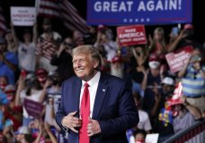 "FILE - In this Sept. 8, 2020, file photo President Donald Trump stands on stage after speaking at a campaign rally at Smith Reynolds Airport in Winston-Salem, N.C. Senior aides describe North Carolina as a ""must-win"" for the Republican president. A loss in North Carolina, which Democrats have carried only once at the presidential level in the last 30 years, would make Trump's path to a second term incredibly difficult and signal dire challenges elsewhere on the electoral map. (AP Photo/Evan Vucci, File)"