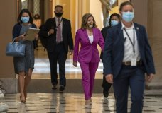 House Speaker Nancy Pelosi of Calif., center, walks to her office, Monday, Sept. 14, 2020, on Capitol Hill in Washington. (AP Photo/Jacquelyn Martin)