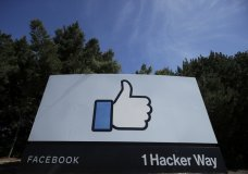 "FILE - In this April 14, 2020 file photo, the thumbs up Like logo is shown on a sign at Facebook headquarters in Menlo Park, Calif. Facebook said Tuesday, Sept. 1 that it removed a small network of accounts and pages linked to Russia's Internet Research Agency, the ""troll factory"" that has used social media accounts to sow political discord in the U.S. since the 2016 presidential election. (AP Photo/Jeff Chiu, File)"