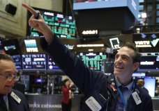 FILE - In this March 10, 2020, file photo, traders Steven Kaplan, left, and Gregory Rowe react at the closing on the floor of the New York Stock Exchange. Wall Street is opening slightly higher, Tuesday, Sept. 22, 2020, as markets recover from steep losses Monday. (AP Photo/Richard Drew, File)