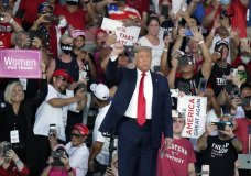 Supporters cheer as President Donald Trump arrives at a campaign rally at the Orlando Sanford International Airport Monday, Oct. 12, 2020, in Sanford, Fla. (AP Photo/John Raoux)
