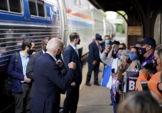 Democratic presidential candidate former Vice President Joe Biden greets supporters on the platform outside the Amtrak's Greensburg Train Station, Wednesday, Sept. 30, 2020, in Greensburg, Pa. Biden is on a train tour through Ohio and Pennsylvania today. (AP Photo/Andrew Harnik)