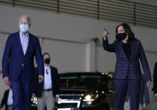 In this Oct. 8, 2020, photo, Democratic presidential candidate former Vice President Joe Biden and vice presidential candidate Sen. Kamala Harris, D-Calif., walk in a hanger before leaving Phoenix Sky Harbor International Airport, in Phoenix. Biden's presidential campaign says Harris will suspend in-person events until Oct. 19, after two people associated with the campaign tested positive for coronavirus. (AP Photo/Carolyn Kaster)