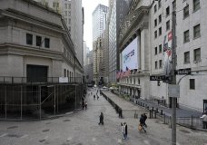 Visitors to the financial district walk past the New York Stock Exchange, Wednesday, Oct. 28, 2020, in New York. U.S. stocks are drifting on Thursday after better-than-expected reports on the economy help stabilize Wall Street following its worst rout in months. (AP Photo/Mary Altaffer)