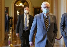 Senate Majority Leader Mitch McConnell of Ky., walks back to his office on Capitol Hill in Washington, Wednesday, Dec. 30, 2020. (AP Photo/Susan Walsh)