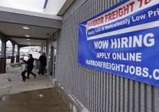 "A ""Now Hiring"" sign hangs on the front wall of a Harbor Freight Tools store, Thursday, Dec. 10, 2020, in Manchester, N.H. The number of Americans seeking unemployment benefits fell by 19,000 to a still-high 787,000, evidence that the job market remains under stress as a resurgent coronavirus continues to batter the economy. (AP Photo/Charles Krupa)"