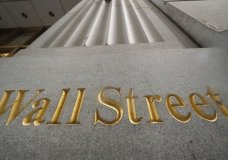 FILE - In this Nov. 5, 2020 file photo, a sign for Wall Street is carved in the side of a building. Stocks rose on Wall Street, Wednesday, Dec. 30, putting the market back on a positive footing following a modest pullback the day before. (AP Photo/Mark Lennihan, File)