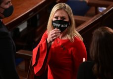 """Rep. Marjorie Taylor Greene, R-Ga., wears a """"Trump Won"""" face mask as she arrives on the floor of the House to take her oath of office on opening day of the 117th Congress at the U.S. Capitol in Washington, Sunday, Jan. 3, 2021. (Erin Scott/Pool via AP)"""