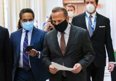 Rep. David Cicilline, D-R.I., is followed by reporters as he walks outside the House Chamber at the Capitol, Monday, Jan. 11, 2021, in Washington. (AP Photo/Manuel Balce Ceneta)