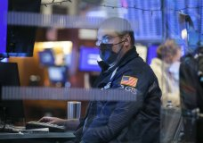 In this photo provided by the New York Stock Exchange, a specialist works at his post on the trading floor, Thursday, Jan 28, 2021. Stocks were moving sharply higher Thursday morning, a day after sinking to their worst loss since October amid lingering worries about the long-term economic damage from the pandemic. (Courtney Crow/New York Stock Exchange via AP)