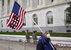 A protester walks past the Russell Senate Office Building on Capitol Hill in Washington, Friday, Jan. 8, 2021. (AP Photo/Patrick Semansky)