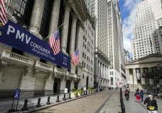 FILE - In this Oct. 2, 2020 file photo, pedestrians pass the New York Stock Exchange in New York. Stocks are off to a strong start on Wall Street, Tuesday, Jan. 26, 2021, as the market finds its bearings following a bumpy ride a day earlier. (AP Photo/John Minchillo, File)