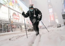 Steve Kent skis through Times Square during a snowstorm, Monday, Feb. 1, 2021, in the Manhattan borough of New York. (AP Photo/John Minchillo)
