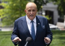 FILE - Rudy Giuliani, a personal attorney for President Donald Trump, talks with reporters outside the White House, Wednesday, July 1, 2020, in Washington. A voting technology company is suing Fox News, three of its top hosts, Giuliani and Sidney Powell for $2.7 billion, charging that the defendants conspired to spread false claims that the company helped steal the U.S. presidential election away from former President Donald Trump. (AP Photo/Evan Vucci, File)
