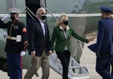 President Joe Biden and first lady Jill Biden are greeted as they walk from Marine One towards Air Force One at Andrews Air Force Base, Md., Friday, Feb. 26, 2021. They are en route to Houston to survey damage caused by severe winter weather and encourage people to get their coronavirus shots. (AP Photo/Susan Walsh)
