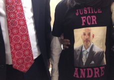 FILE - Andre Hill, fatally shot by Columbus police on Dec. 22, is memorialized on a shirt worn by his daughter, Karissa Hill, on Thursday, Dec. 31, 2020, in Columbus, Ohio. A white Ohio police officer was indicted Wednesday, Feb. 3, 2021 on murder charges in the December shooting death of 47-year-old Andre Hill. Columbus Police Officer Adam Coy was indicted by a Franklin County grand jury on Wednesday following an investigation by the Ohio Attorney General's office. (AP Photo/Andrew Welsh-Huggins)