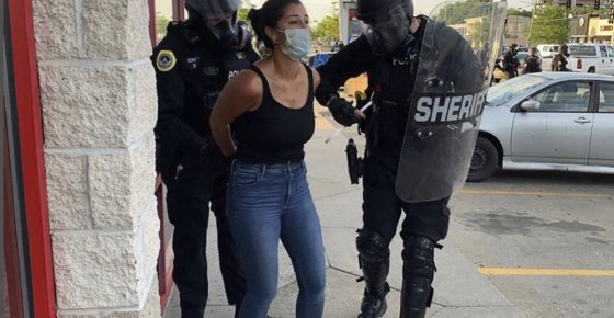 Police officers are shown arresting Des Moines Register reporter Andrea Sahouri after a Black Lives Matter protest she was covering on May 31, 2020, in Des Moines, Iowa, was dispersed by tear gas. Sahouri is set to stand trial on Monday, March 8, 2021, on misdemeanor charges, a case that prosecutors have pursued despite international condemnation from advocates for press freedom. (Photo courtesy Katie Akin via AP)