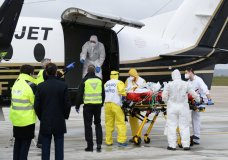 FILE - In this March 14, 2021, file photo, a patient infected with COVID-19 is loaded into a plane heading to a western France hospital, at Orly airport, south of Paris. Health experts say the surge in coronavirus cases in Europe should serve as a warning to the U.S. not to drop its safeguards too early. (Jaques Witt/Pool Photo via AP, File)