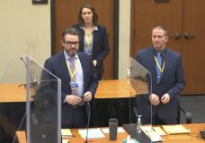 In this image taken from video, defense attorney Eric Nelson, left, defendant former Minneapolis police officer Derek Chauvin, right, and Nelson's assistant Amy Voss, back, introduce themselves to jurors as Hennepin County Judge Peter Cahill presides over jury selection in the trial of Chauvin, Monday, March 22, 2021, at the Hennepin County Courthouse in Minneapolis. Chauvin is charged in the May 25, 2020, death of George Floyd. (Court TV via AP, Pool)