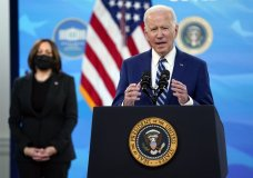 President Joe Biden speaks during an event on COVID-19 vaccinations, in the South Court Auditorium on the White House campus, Monday, March 29, 2021, in Washington, as Vice President Kamala Harris listens. (AP Photo/Evan Vucci)