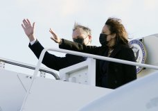 Vice President Kamala Harris and her husband, Doug Emhoff, wave as they board Air Force Two at Andrews Air Force Base, Md., Monday, March 15, 2021, en route to Las Vegas. President Joe Biden, Vice President Kamala Harris and their spouses are opening an ambitious, cross-country tour to highlight the $1.9 trillion coronavirus relief plan and its benefits. (AP Photo/Jacquelyn Martin)