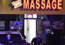 CORRECTS DATELINE TO ACWORTH INSTEAD OF WOODSTOCK - Authorities investigate a fatal shooting at a massage parlor, late Tuesday, March 16, 2021, in Acworth, Ga. Officials say 21-year-old Robert Aaron Long, of Woodstock, Georgia, has been captured hours after multiple people were killed in shootings at three Atlanta-area massage parlors. (AP Photo/Mike Stewart)