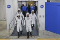 The Crew Dragon space capsule astronauts, from front left; NASA astronaut Megan McArthur, NASA astronaut Shane Kimbrough and back row European Space Agency astronaut Thomas Pesquet and Japan Aerospace Exploration Agency astronaut Akihiko Hoshide leave the Operation and Checkout Building on their way to board the capsule for a mission to the International Space Station at the Kennedy Space Center in Cape Canaveral, Fla., Friday, April 23, 2021. (AP Photo/John Raoux)