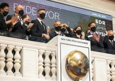 In this photo provided by the New York Stock Exchange, Endeavor CEO Ariel Emanuel, fourth left, rings the NYSE opening bell, to celebrate his company's IPO, Thursday, April 29, 2021. Stocks edged mostly higher in midday trading Thursday, helped by big technology companies that reported strong results overnight and more economic data pointing to a solid recovery. (Courtney Crow/New York Stock Exchange via AP)