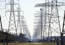 FILE - This Tuesday, Feb. 16, 2021 file photo shows power lines in Houston. The Biden administration is taking steps to protect the country's electric system from cyberattacks through a new 100-day...
