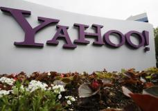 FILE - The Yahoo logo is displayed outside of offices in Santa Clara, Calif., in this Monday, April 18, 2011, file photo. Verizon is selling the segment of its business that includes Yahoo and AOL to private equity firm Apollo Global Management in a $5 billion deal. Verizon said Monday, May 3, 2021, that it will keep a 10% stake in the new company, which will be called Yahoo. (AP Photo/Paul Sakuma, File)