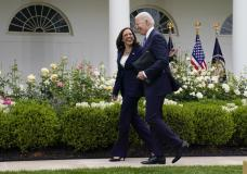 President Joe Biden walks with Vice President Kamala Harris after speaking on updated guidance on face mask mandates and COVID-19 response, in the Rose Garden of the White House, Thursday, May 13, 2021, in Washington. (AP Photo/Evan Vucci)